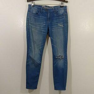 Madewell distress jeans.